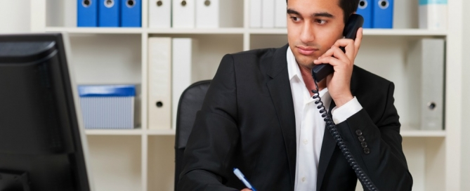 Man on the phone at a desk